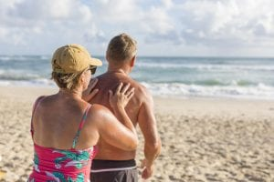 Mature couple applying sunscreen