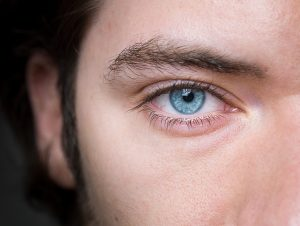 Close up of man's blue eye