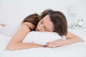 Woman sleeping with her face on pillow