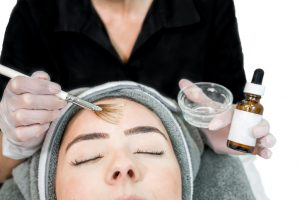 Woman undergoing chemical peel
