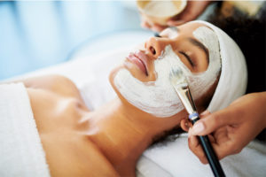 young woman during facial treatment at Water's Edge Dermatology