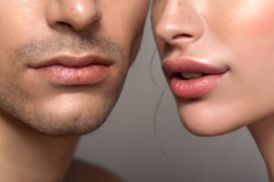 Closeup of a beautiful man and woman with a focus on the lips free of cold sores